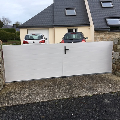 Pose d''une porte de garage et d''un portail à Saint cast